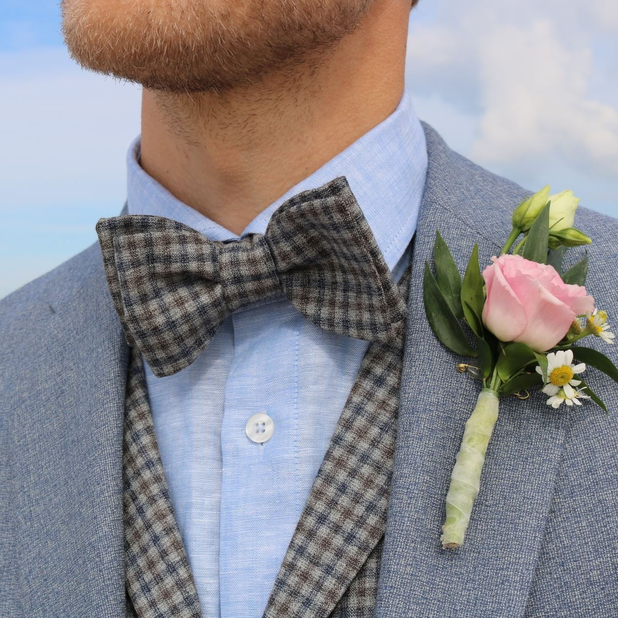 Elegant bow ties matching the wedding suits